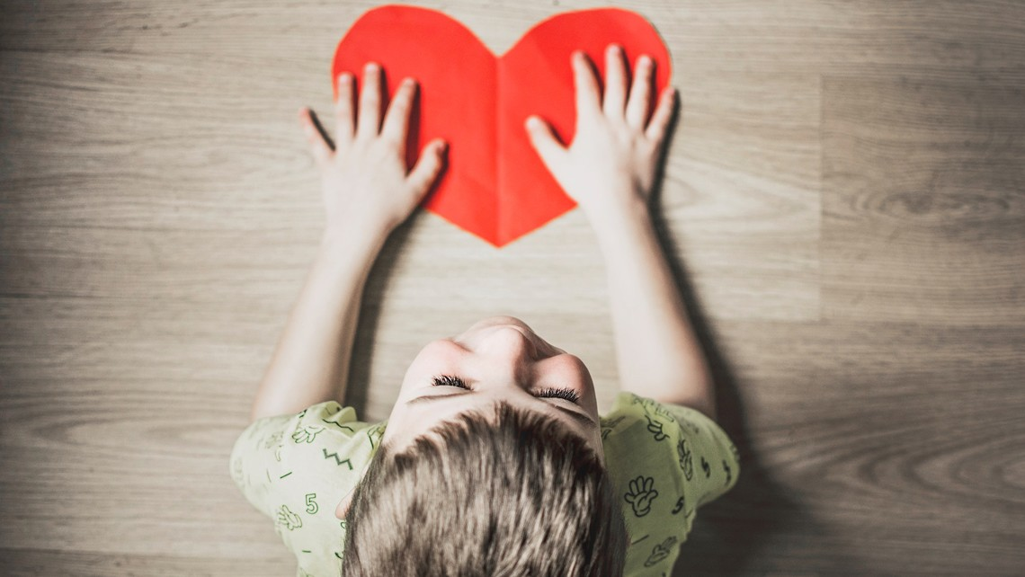 Child with paper heart | BetterBond