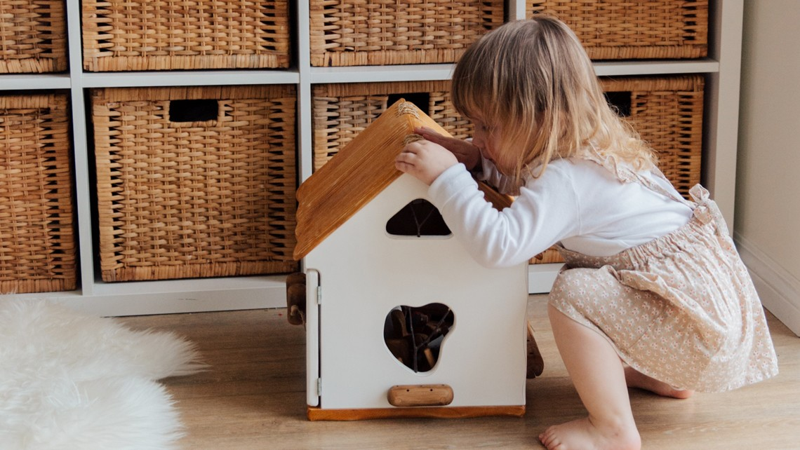 Little girls playing with doll house | BetterBond