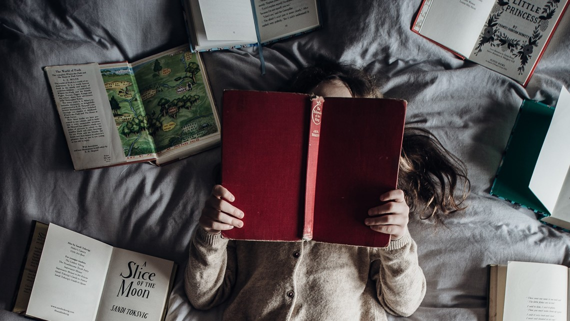 Books spread on bed | BetterBond